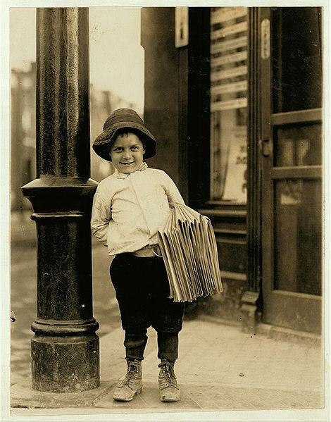 Newsboy. Little Fattie. Less than 40 inches high, 6 years old. Been at it one year. May 9th, 1910. Location: St. Louis, Missouri. Wikimedia Commons image, original at Library of Congress.