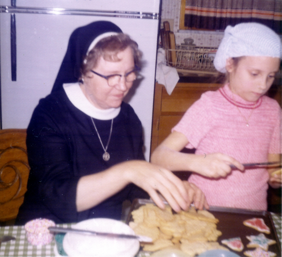 holiday heritage recipes : Lisa Alzo and Sr. Camilla Alzo making Christmas cookies in December 1972.