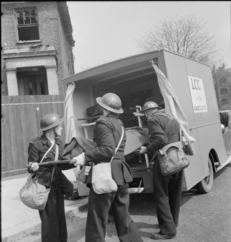 WWII photos The_Reconstruction_of_'an_Incident'-_Civil_Defence_Training_in_Fulham,_London,_1942_D7917