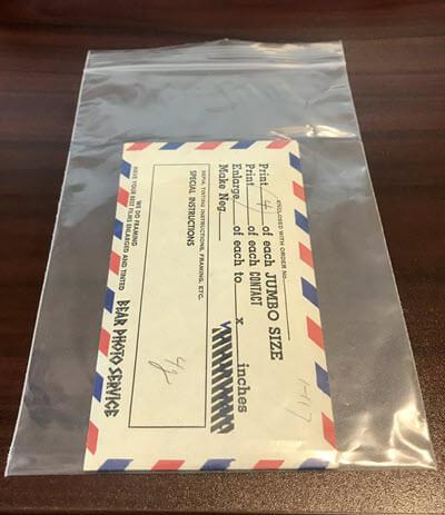 Digitized Old negatives returned in their original envelope safe and sound